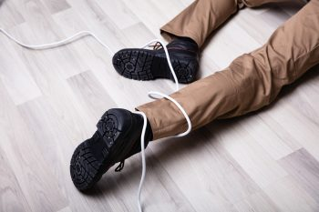 man on floor tripped on cables