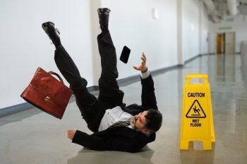 Man slipping wet floor