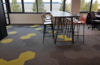 Hexagonal floor tiles. Hexagon carpet tiles in office design