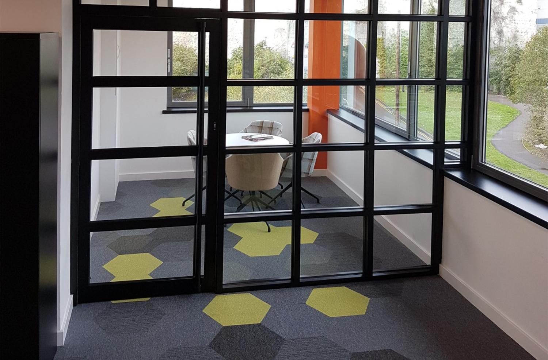 Hexagon carpet tiles in office design