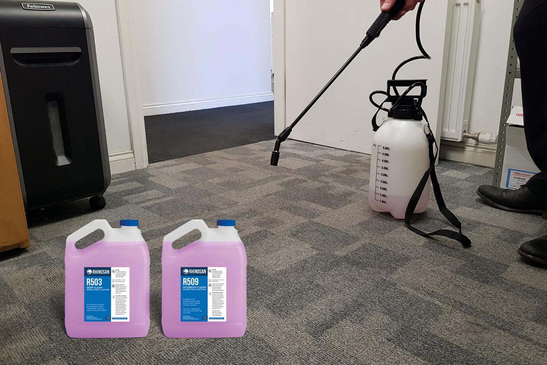 Deep Clean sanitiser on carpet tiles in office