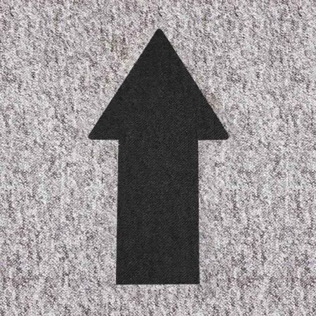 Social distancing marker black arrow on grey tile